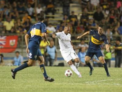 Fort Lauderdale Strikers midfielder Gabriel Rodrigues dos Santos cuts between two Boca Juniors players in an international friendly match on July 1 at Lockhart Stadium. (Photo courtesy of Jon van Woerden / Fort Lauderdale Strikers)