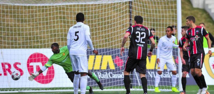 Colin Falvey takes a shot on goal