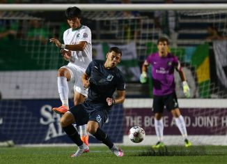 Samuel Caceres and Christian Ramirez tangle for a ball as Jimmy Maurer looks on (Photo: New York Cosmos)