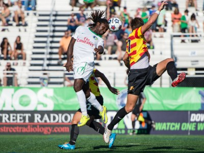 Lucky Mkosana Heads a Ball on Past the Strikers Defense (Photo Credit: New York Cosmos)