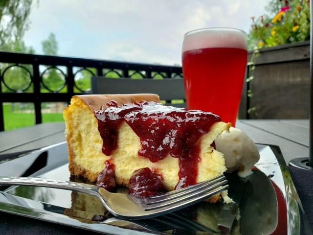 Cheesecake plated and served with a side of ice cream and a pint of our Jenny's Raspberry Sour