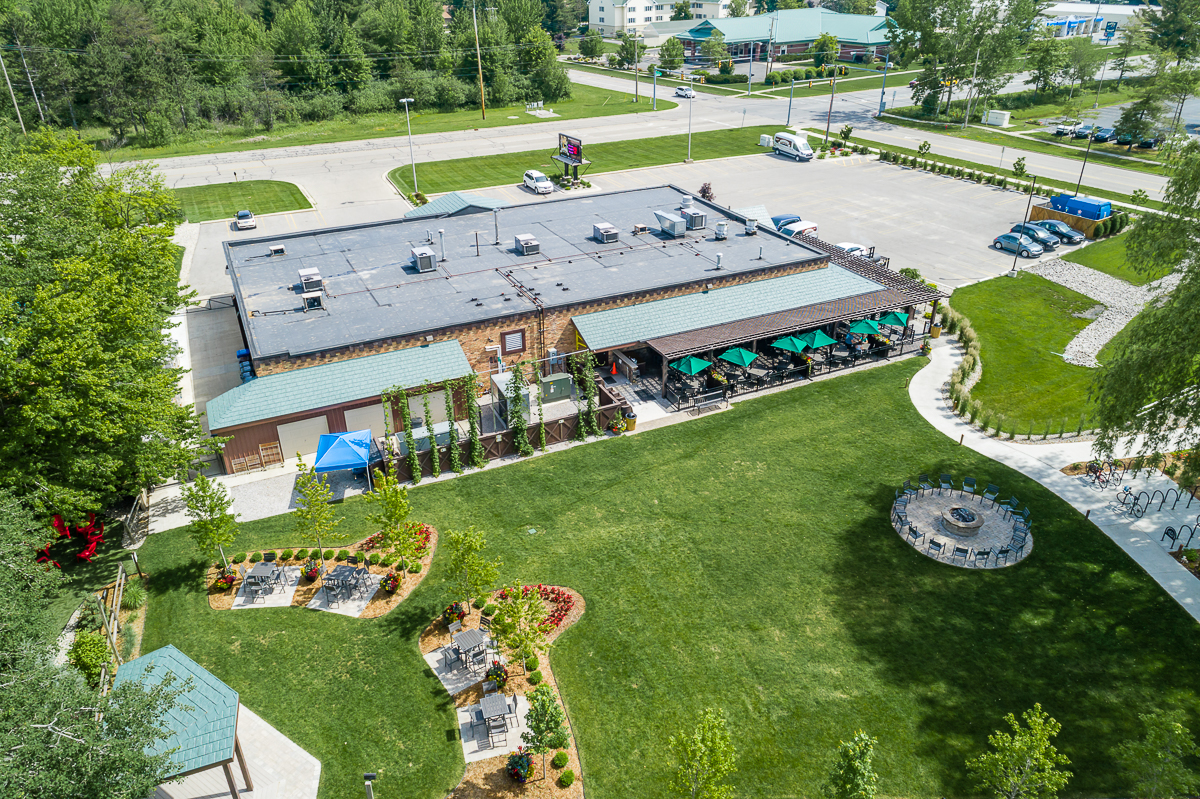 An aerial view shot from a drone of Midland Brewing Company's backyard and building.