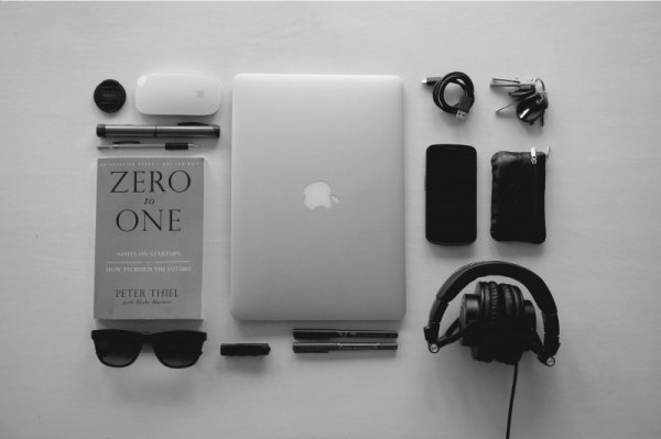 black-and-white-image-of-laptop-book-and-headphones.jpg