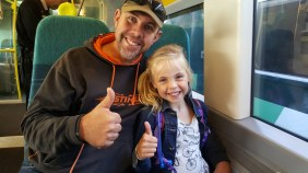 Grant and Holly on the train into the city