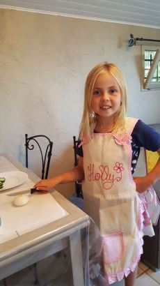 Holly preparing dinner with her new personalised apron.