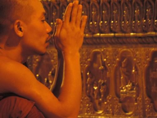 A prayer at Shwedagon Pagoda, Burma