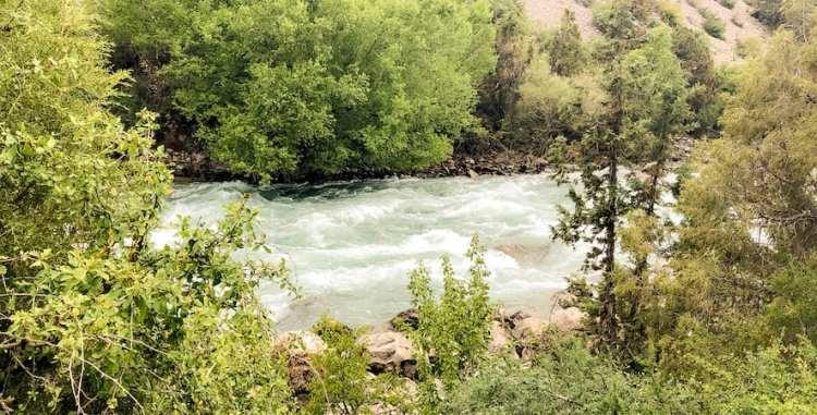 Icy river near Iskanderkul Lake in Tajikistan