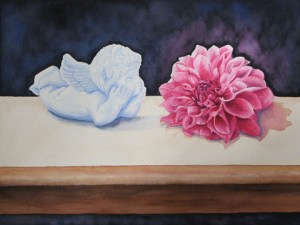 Small cherub statue and red flower sitting on a white table cloth.