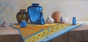 Portrait of blue and brown glass jars within on a table on top of a blue and yellow cloth, with onions.
