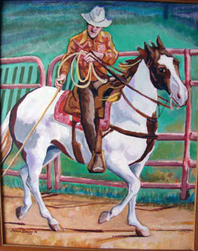 Cowboy hold a rope on top of a white and brown horse.