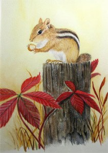 Chipmunk sitting on a post with red leaves.