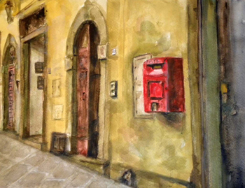 Arched doorway with red box on the wall.