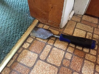 removing carpet - first chisel under the transition strip