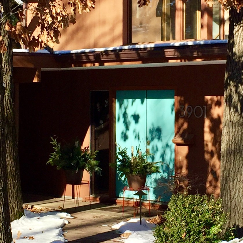 Robin's Egg blue double door with big neutra house numbers and covered portico