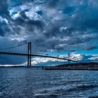 A storm breaks over the Mt Hope Bridge inbetween bristol and portsmouth Rhode Island