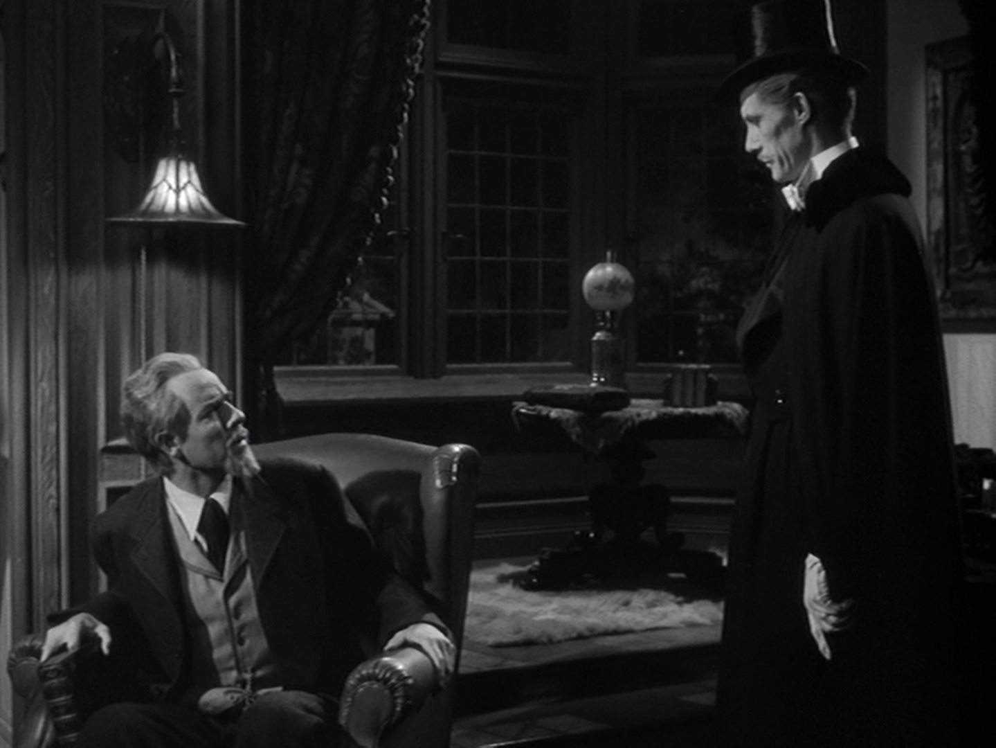 werewolf midnite reviews the help of his hunchbacked assistant nina jane adams the kindly dr franz edlemann onslow stevens attempts to cure larry talbot and count dracula