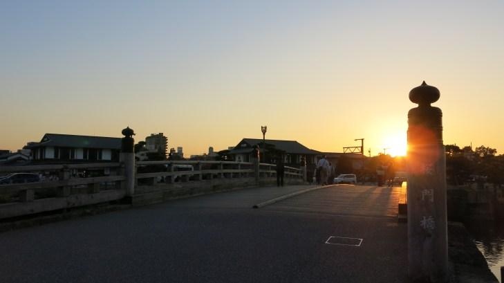 Sakura Gate Bridge framing the sunset