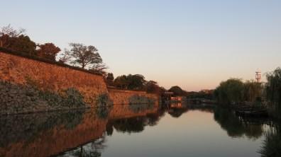 serene lake surrounding Himeji Castle grounds