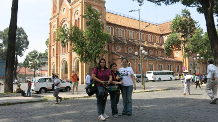 Churches usually have interesting architecture. Behind us is a replica of France's Notre Dame cathedral in Ho Chi Minh.