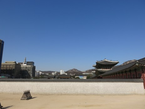 from this angle, it looks like the modern buildings are within the palace grounds, too