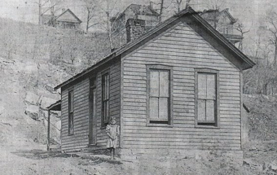 Before it became a major city park, Penn Valley was a deep ravine with 300 homes scattered across its hillsides, as seen in this photo from 1890. Photo courtesy Board of Park and Recreation Commissioners as seen in Kansas City's Parks and Boulevards.