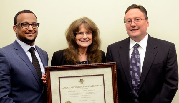 National Association of Medical Examiners Site Inspector Dr. Roger Mitchell (left) presented Jackson County Chief Medical Examiner Dr. Mary Dudley and County Executive Mike Sanders with the NAME accreditation certificate. The inspectors found no deficiencies. Courtesy Jackson County.  during the accreditation process.