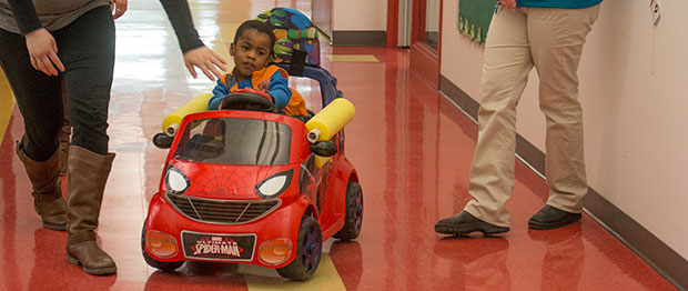 """Trace Bales checked out his new """"adapted car"""" at the Children's Center for the Visually Impaired today. The low-cost, low-tech cars can replace powered wheelchairs for children who can't move on their own."""