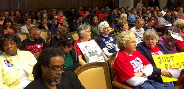 Those interested in the minimum wage issue filled the city council chamber yesterday for a hearing.