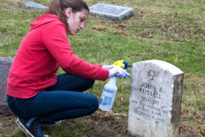student-cleaning-grave-2