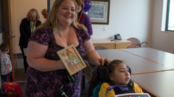 Katherine Talbot holds a photo of Terri LaManno and her daughter Layla.