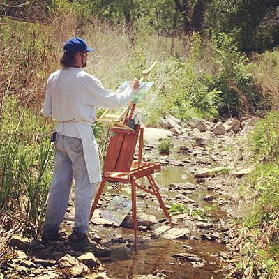Alex Hamil paints at the 2015 Penn Valley Park Plein Air fest, where he won second place