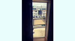Balcony overlooking parking lot of an updated campus apartment
