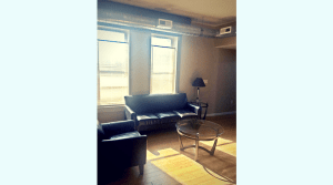 Furnished living room in a campus apartment