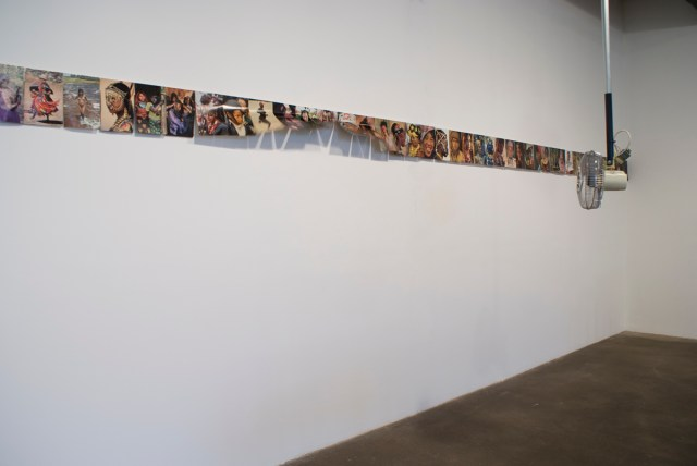 Turn, Turn, 2009. Paper, wood, fan, metal pole. Dimensions variable.