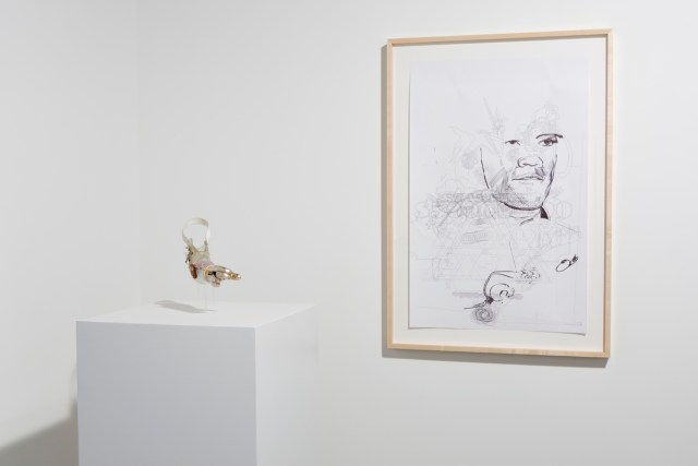 For Rent, installation view. Left: Untitled, 2007. Gilded prosthesis with Swarovski crystals. Right: Untitled, 2007. Ball point pen on paper.
