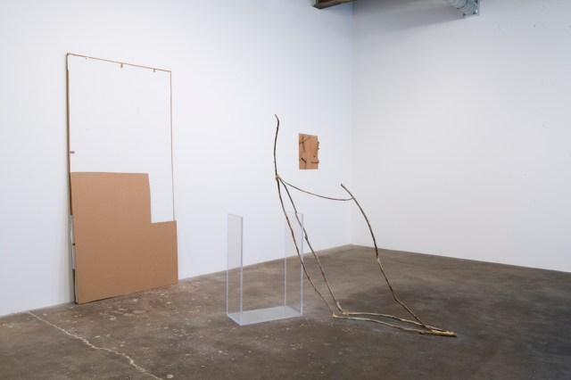 Foreground: Keep States Of Affairs, 2005/2007. Cardboard, latex paint, Plexiglas, sticks, wood glue. Background: Undeterred, 2006. Hollow-core door fragments.