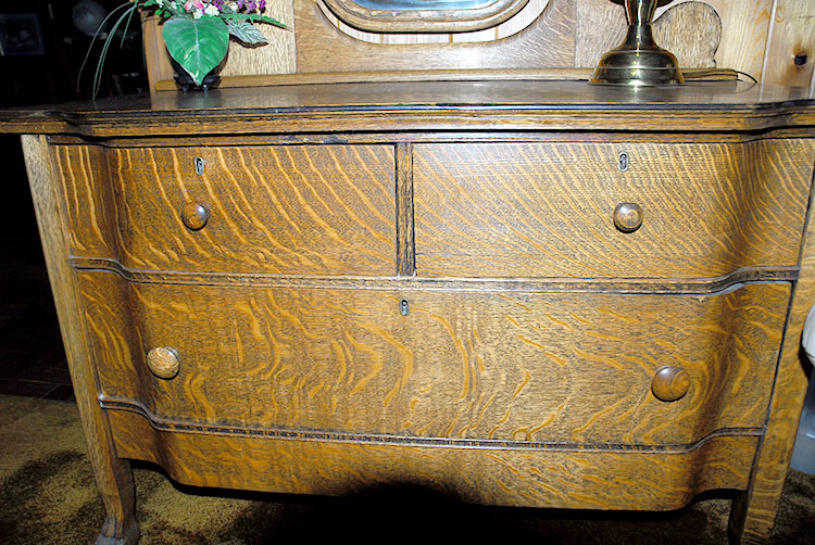 American Oak dresser with swell front claw feet and French beveled mirror  1195