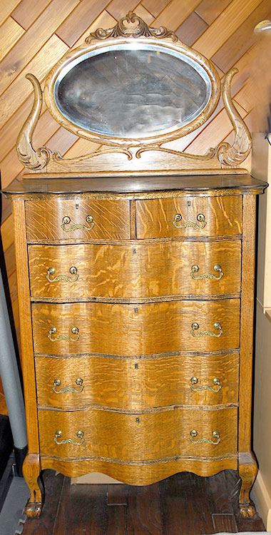 American Oak 6 drawers highboy chiffonier with claw feet serpantine front an oval beveled