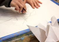 Advanced art students working on Folded Gestures: Playing with Form and Space