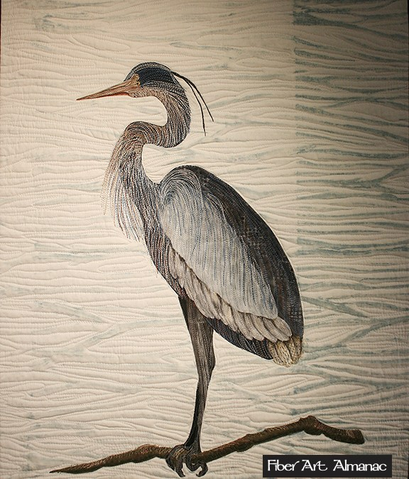Thread painted art quilt…stitching a blue heron