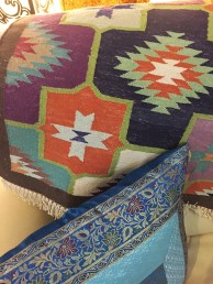 Colorful Dhurrie rug.