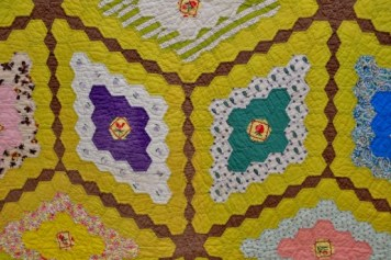 Hexagonal Quilts in the Barn Gallery at WMQFA