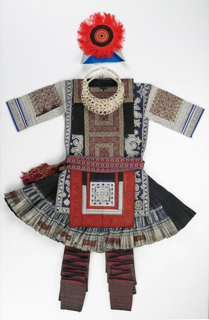 China, 20th century Woman's Skirt, Jacket, Sash, Apron, Hat and Necklace Cotton, silk, embroidery, indigo dye, beads The Helen Jones Fund for Asian Art, 98.15.4 (skirt), 94.54.8 (sash), 94.54.3 (apron), 96.91.6a,b (hat) The Ethel Morrison Van Derlip Fund and Gift of funds from Thirza Cleveland and Joan Wurtele, 95.43.34 (coat) The Suzanne S. Roberts Fund for Asian Art, 2003.134.12 (necklace)