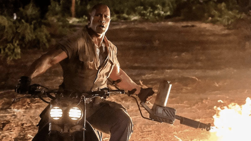 "Dwayne Johnson multitasks in ""Jumanji: Welcome to the Jungle,"" a Sony Pictures release."
