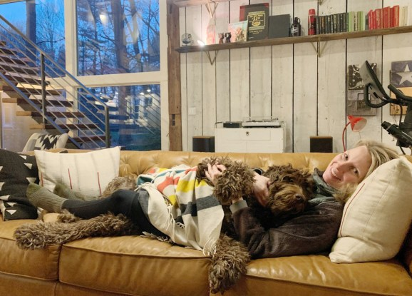This image has an empty alt attribute; its file name is Midwest-Labradoodle-Laddie-Laying-With-His-Mommy.jpg