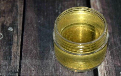 Homemade Vanilla Lip Balm in clear lip balm pots