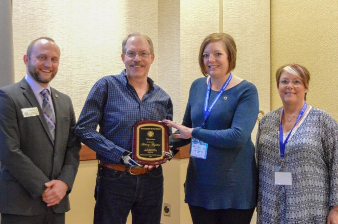 MWA Chair Chris Hare, DSA-NASCOE winner Tony Augustine, MWA Awards Chair, Kathy Balbaugh, IL President, Debbie Staley