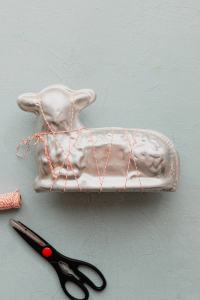 A lamb cake mold is closed and secured with butcher's twine.