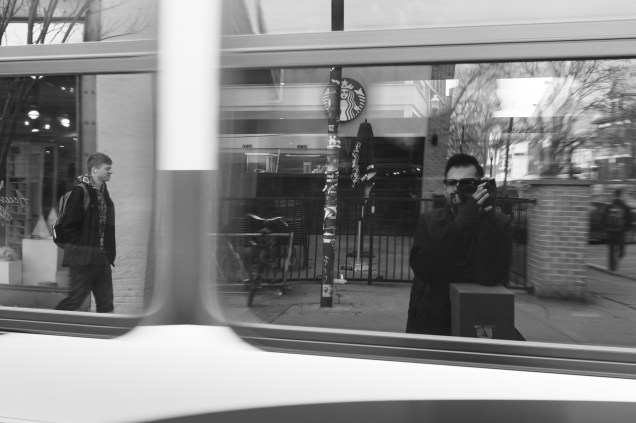 1/50 @ f/8.0, ISO 1600. This bus was moving and you can see the reflection off of the windows, in addition to seeing through to the far windows. Look how pleased the guy on the left is... shot in manual mode because i wanted a slower shutter speed.