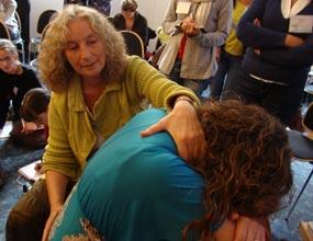 Verena showing massage to restart labor
